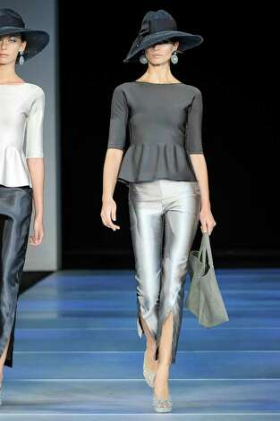 Tight shiny capri pants are teamed with a fitted peplum top for a 1960's Marilyn Monroe vibe from Giorgio Armani's ready to wear Spring Summer 2012 collection. Photo: Ze TAKAHASHI / Ze TAKAHASHI