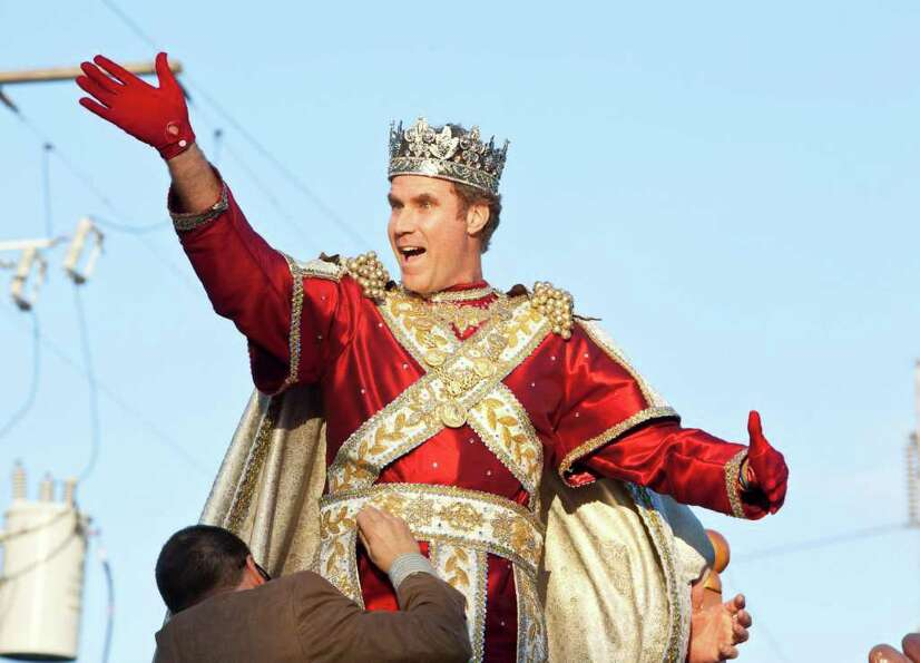 Actor and comedian Will Ferrell greets fans as he reigns as King of Bacchus in the 2012 Krewe of B