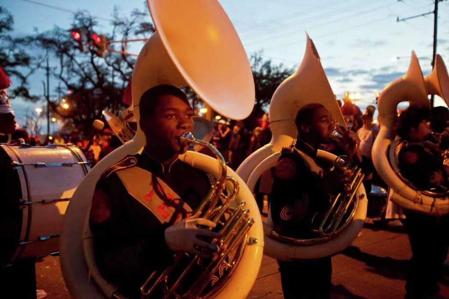 A New Orleans area High School Marching Band in the 2012 Krewe of Bacchus Parade on February 19, 2012 in New Orleans, Louisiana. Photo: Skip Bolen, Getty Images / 2012 Getty Images