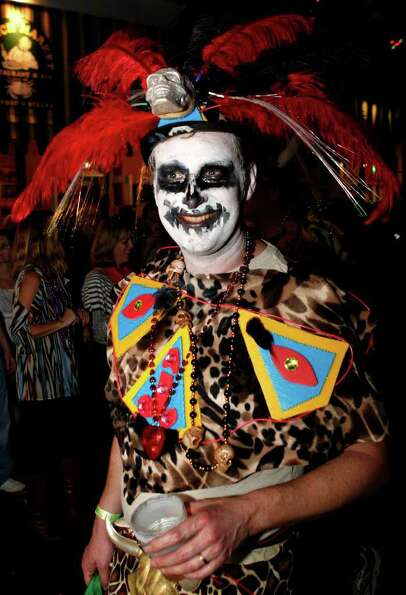 A member of the Krewe du Vieux parades through the streets of the French Quarter celebrating the Mar