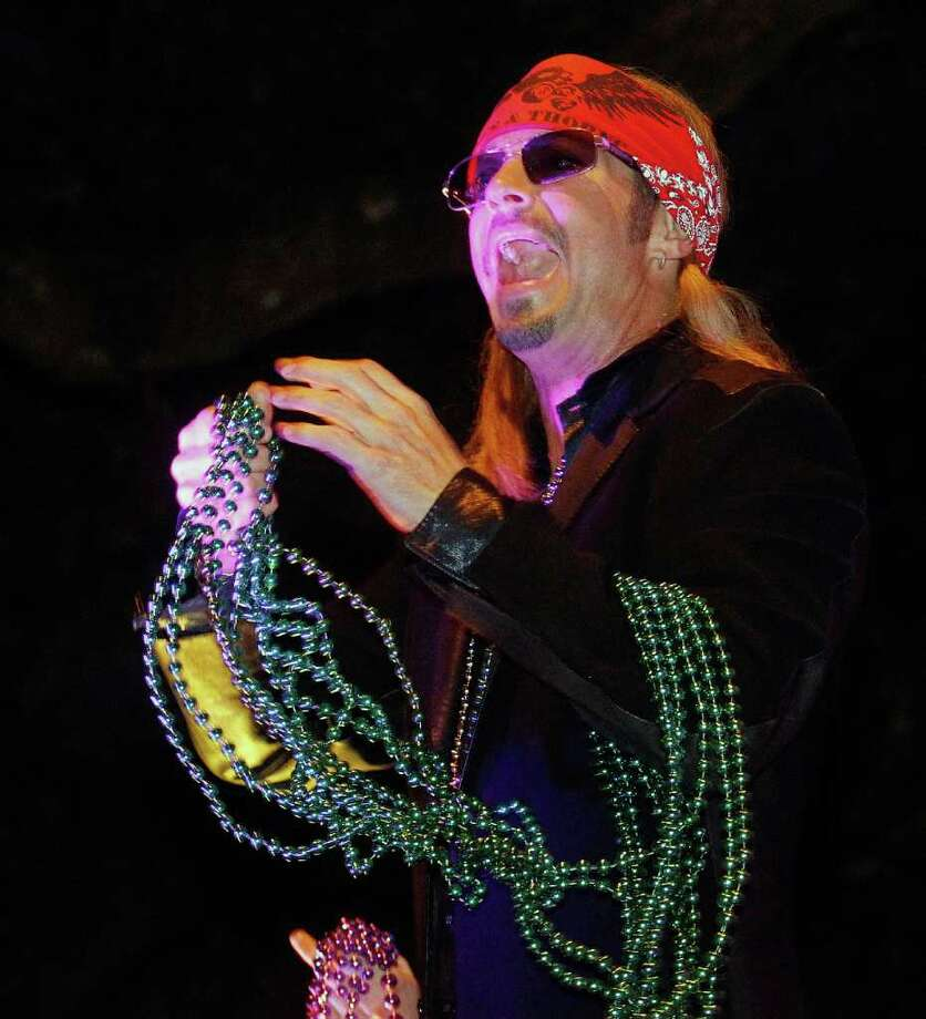 Entertainer Bret Michaels holds a handful of beads while riding in the Mardi Gras parade in New Orleans, Monday, Feb. 20, 2012. Photo: AP