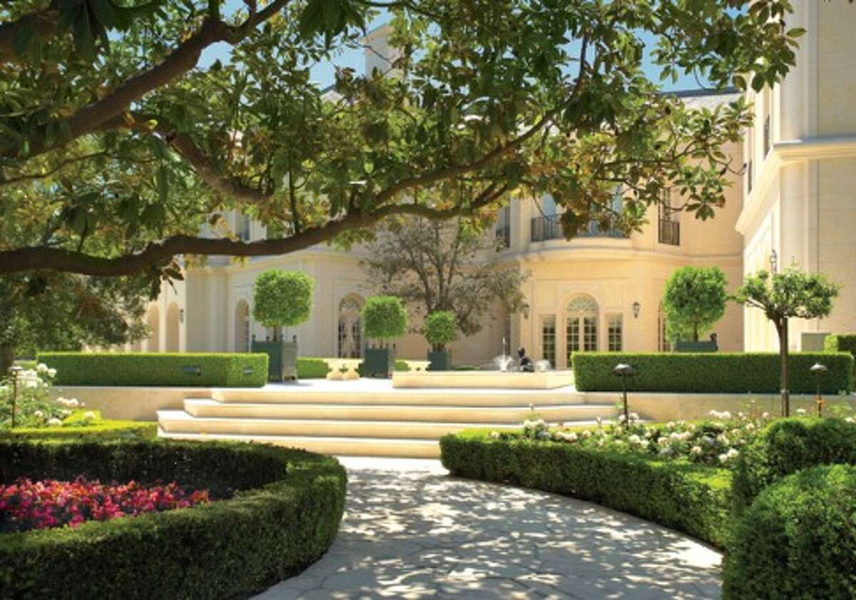 The former Spelling mansion built in 1990 for late TV producer Aaron Spelling and his wife, Candy. The property includes amenities like a swimming pool, bowling alleys, tennis courts, doll rooms and more.