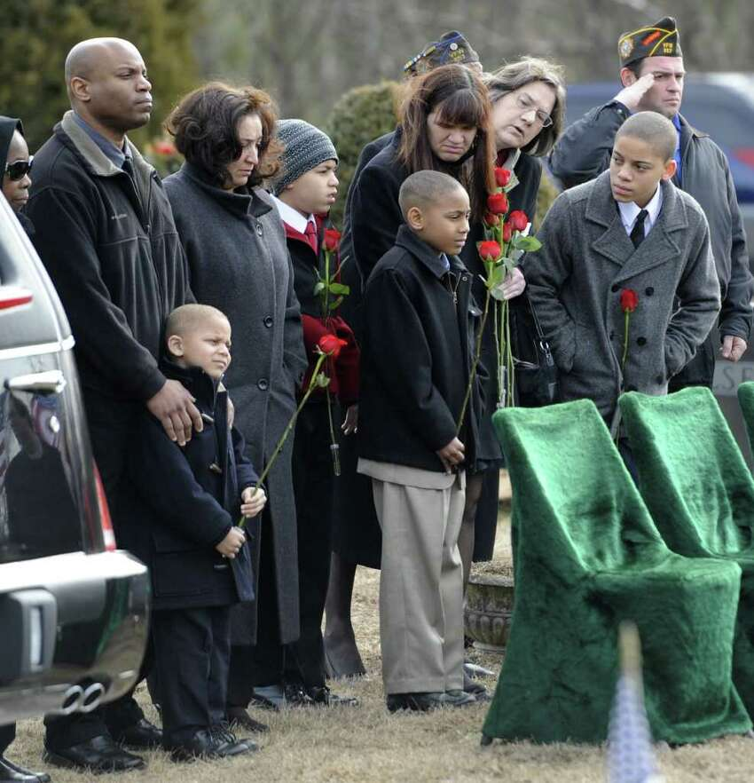Relatives of Clarence Dart gather at graveside at the Green Ridge Cemetery in Saratoga Springs, N.Y. Feb. 21, 2012. Dart, who flew 95 combat missions in World War II and was shot down twice, was a member of the legendary Tuskegee Airmen, the elite African-American pilots, was buried with full military honors at the Green Ridge Cemetery in Saratoga Springs. ( Skip Dickstein / Times Union)