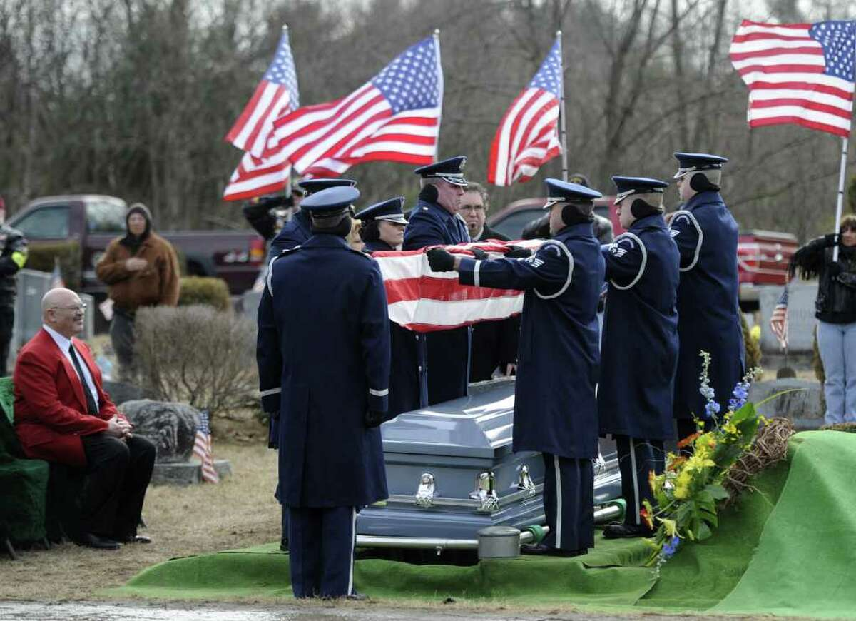 Clarence Dart's son, Warren, left, sits graveside at the Green Ridge Cemetery in Saratoga Springs, N.Y. Feb. 21, 2012. His late father, a member of the legendary Tuskegee Airmen, the elite African-American pilots, flew 95 combat missions in World War II and was shot down twice, was buried with full military honors at the Green Ridge Cemetery in Saratoga Springs. ( Skip Dickstein / Times Union)