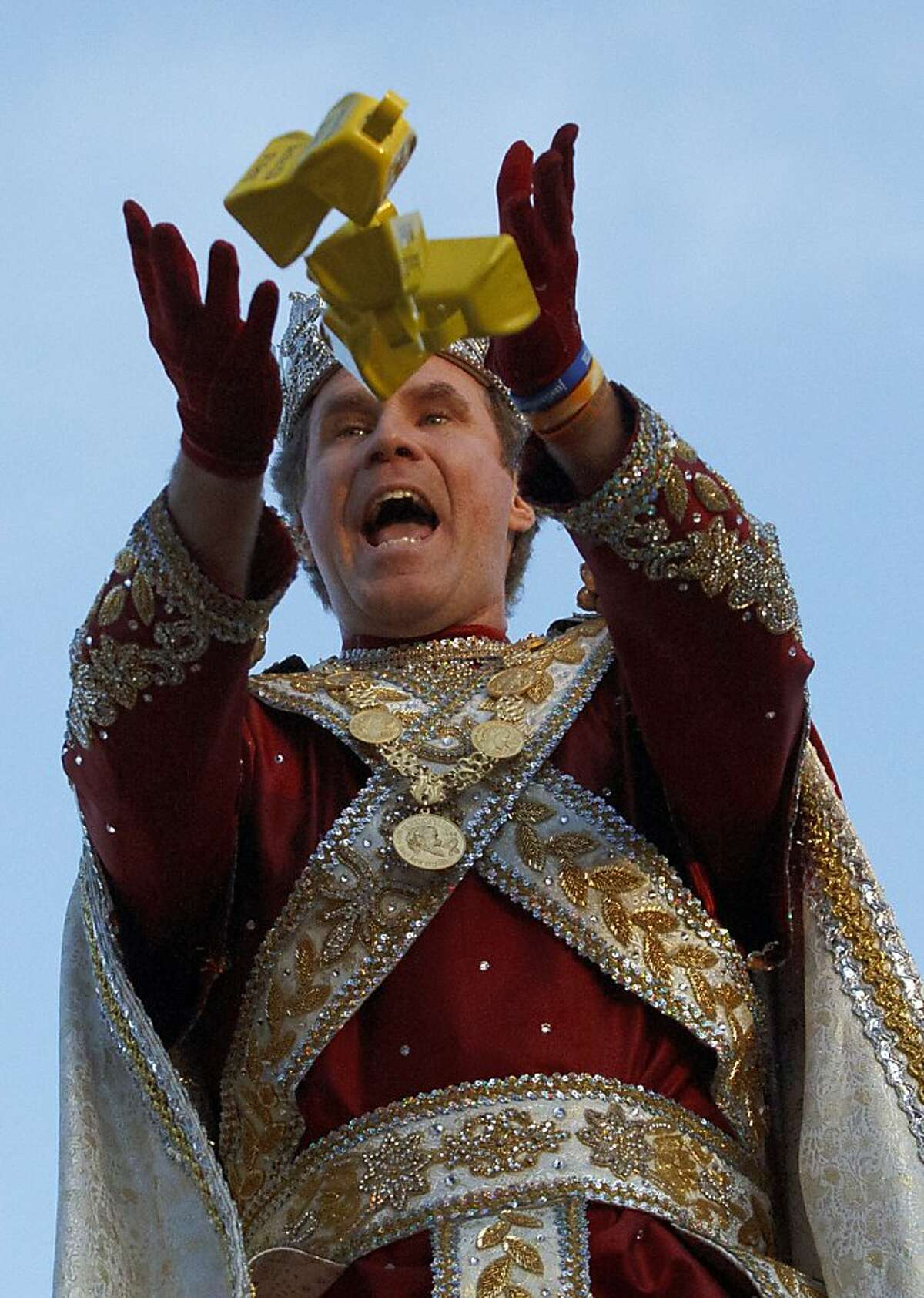 """Actor Will Ferrell reigns as Bacchus XLIV for the Krewe of Bacchus parade on Napoleon Ave. in New Orleans on Sunday, Feb.19, 2012. Ferrell has been in New Orleans since November, filming a movie recently renamed """"The Campaign."""" (AP Photo/The Times-Picayune Matthew Hinton)"""