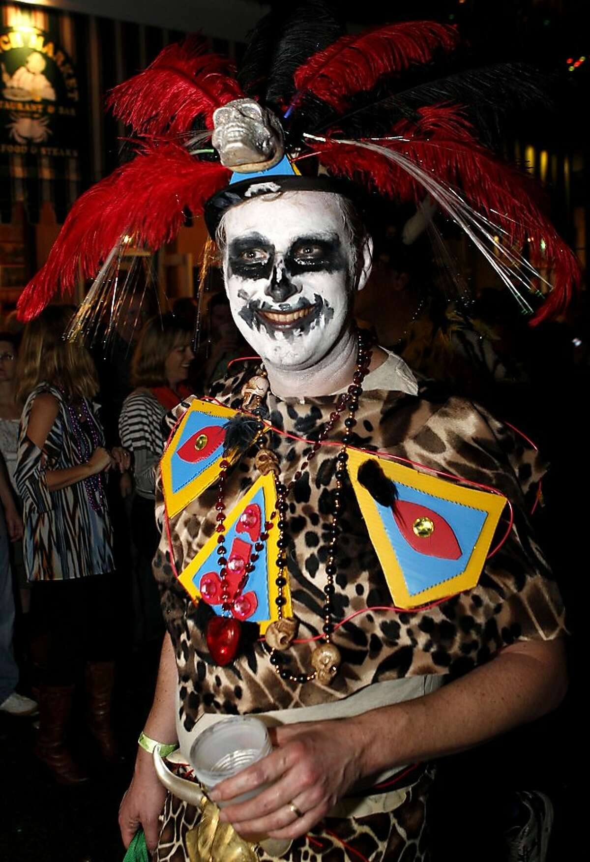 A member of the Krewe du Vieux parades through the streets of the French Quarter celebrating the Mardi Gras season in New Orleans, Saturday, Feb. 4, 2012. The parade is one of the earliest of the Mardi Gras season and is known for its satirical themes.(AP Photo/Jonathan Bachman)