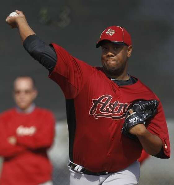 Houston pitcher Livan Hernandez throws at the Astros spring training complex. (Karen Warren / Housto