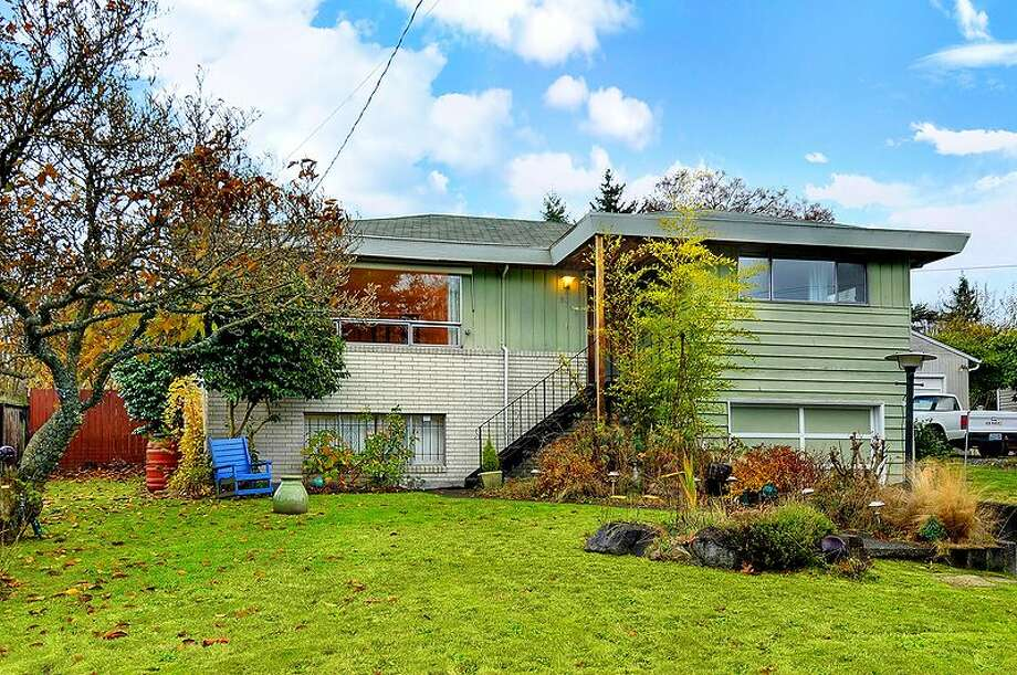 Arbor Heights, at the far southwest end of West Seattle, features nice homes near the water for low prices, by Seattle standards. Here are three listed there for less than $300,000, starting with 9708 37th Ave. S.W. The 2,050-square-foot home, built in 1965, has three bedrooms, 1.75 bathrooms, a circular floor plan, a living room with a large window and fireplace, a family room with a second fireplace, and a 7,260-square-foot lot. It's listed for $299,990. Photo: Matthew Miner/Coldwell Banker Bain