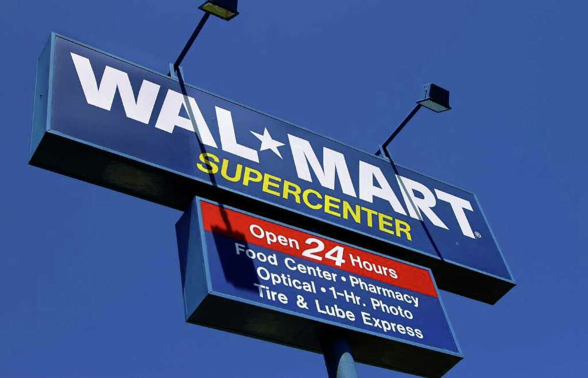 In this file photo, the WalMart Supercenter signage is seen.
