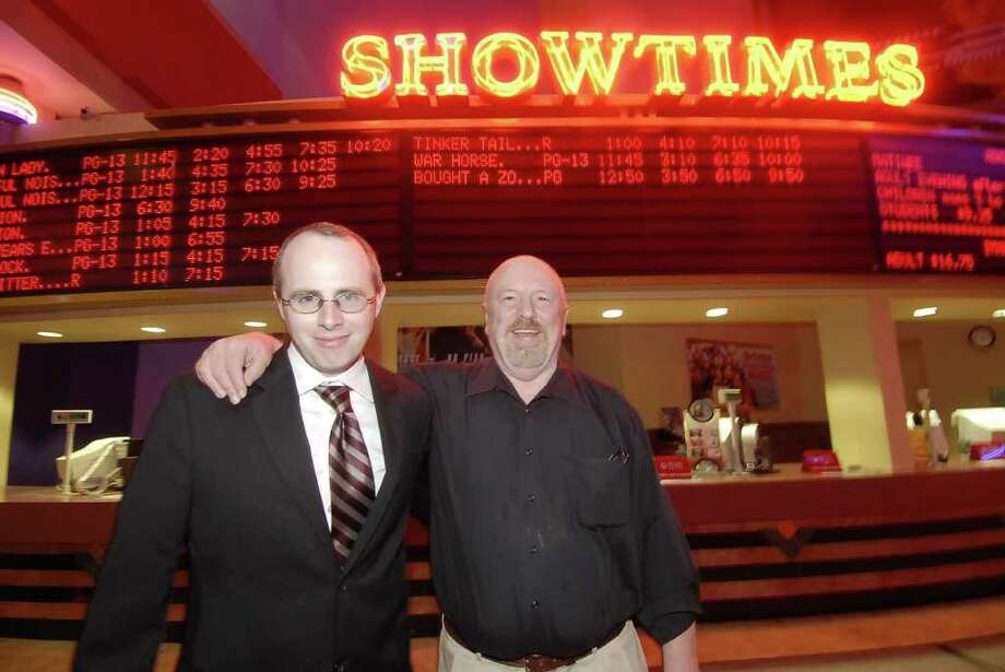 Movie critic Josh Starnes, left, with his dad Reynold Starnes at the Edwards Marq*E Stadium theatres. Photo: Tony Bullard / Tony Bullard & the Houston Chronicle