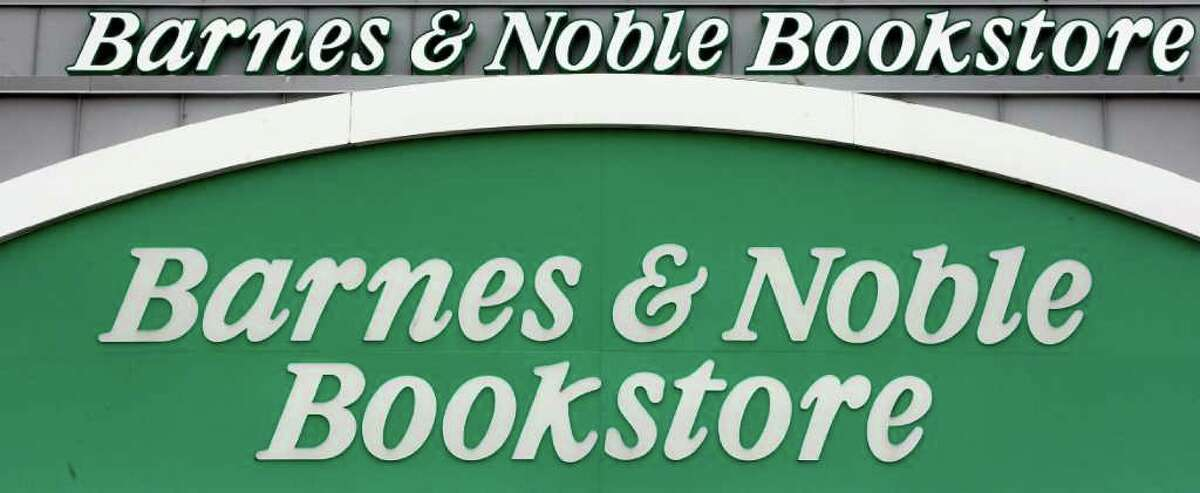 FILE - In this Aug. 29, 2011 file photo, a Barnes & Noble store front is displayed, in Portland, Ore.  (AP Photo/Rick Bowmer, File)