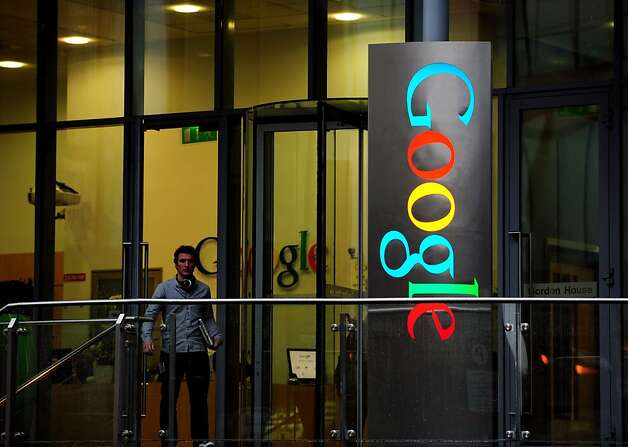 A pedestrian exits Gordon House, the current European headquarters of Google Inc. on Barrow Street in Dubin, Ireland, on Thursday, Feb. 9, 2012. Ireland will give a tax break to ''key'' overseas workers who are assigned to work in the country, Finance Minister Michael Noonan said in an e-mailed statement. Photograph: Aidan Crawley/Bloomberg Photo: Aidan Crawley, Bloomberg