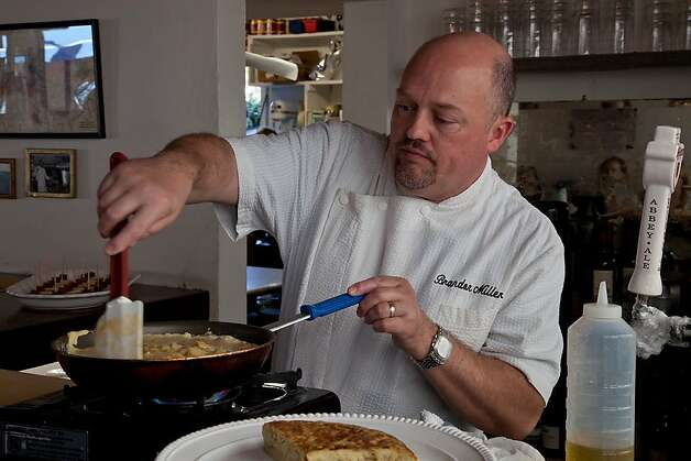 Chef Brandon Miller cooks up a Spanish dish. Photo: Richard Green Photography