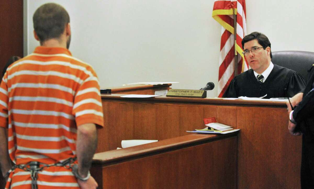 Robert Hayden of Troy, left, is arraigned in Troy City Court by Judge Chris Maier Tuesday Feb. 21, 2012, in connection with the death of toddler found at the Griswold Heights Apartment complex. (John Carl D'Annibale / Times Union archive)