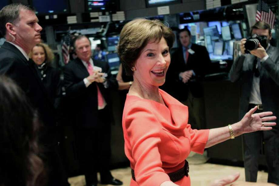 Former First Lady Laura Bush greets traders on the floor at the New York Stock Exchange. Photo: Seth Wenig, Associated Press