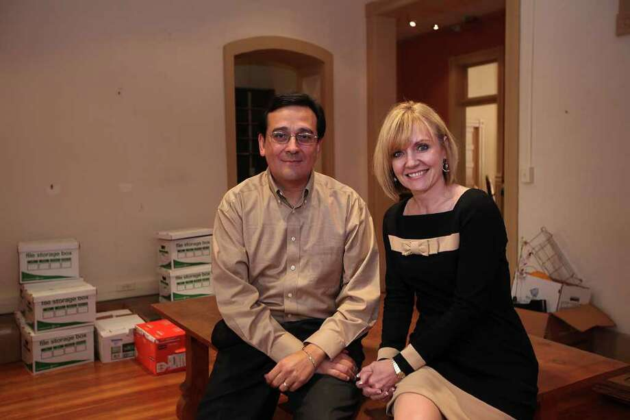 Guerra DeBerry Coody partners Frank Guerra and Trish  DeBerry pose in one of the conference rooms at their current offices on East Houston Street. Photo: Jerry Lara, San Antonio Express-News / © 2012 San Antonio Express-News