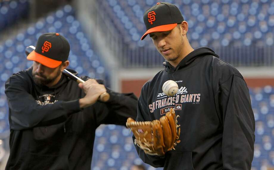 Giants pitchers Jeremy Affeldt, (left) and Madison Bumgarner wait for batting practice as they prepare to take on the Phillies in Game 6 of the NLCS on Saturday at Citizens Bank Park in Philadelphia. Photo: Michael Macor, The Chronicle
