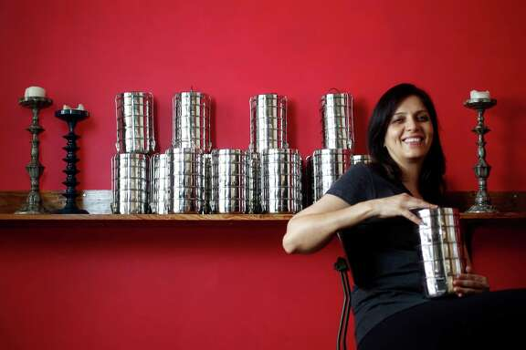 Pondicheri owner Anita Jaisinghani with Tiffin metal containers