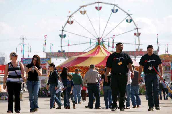 People walk around the stock show grounds Tuesday. Officials say attendance is up over last year at this point.