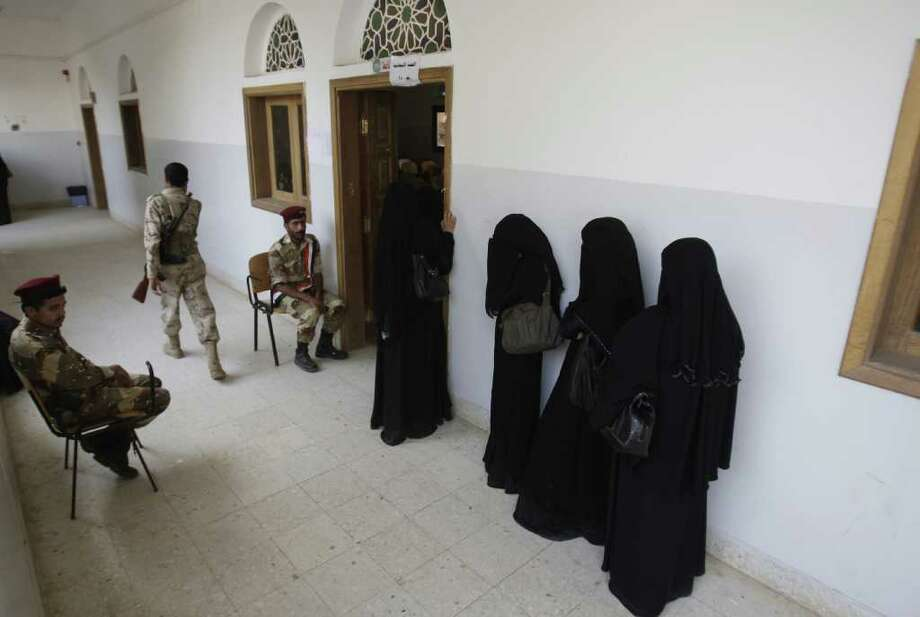 Yemeni women stand in line waiting to cast their votes at a polling station during presidential elections in Sanaa, Yemen, Tuesday, Feb. 21, 2012. Yemenis are voting to rubber-stamp their U.S.-backed vice president as the new head of state tasked with steering the country out of a crisis that followed the year-old anti-government uprising. The vote can hardly be called an election since Abed Rabbo Mansour Hadi is the only candidate. Photo: Hani Mohammed, AP / AP