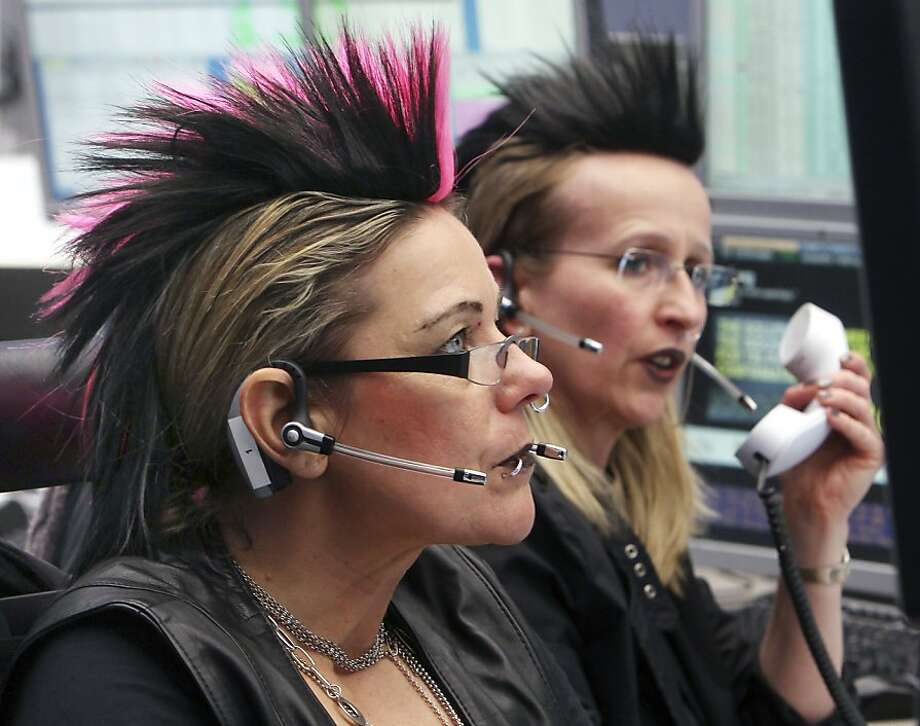 Four hundred shares Deutsche Bank, check. Will that be, like, a limit order, dude? Punked-out brokers work at the stock market on Fat Tuesday in Frankfurt, Germany. Photo: Michael Probst, Associated Press