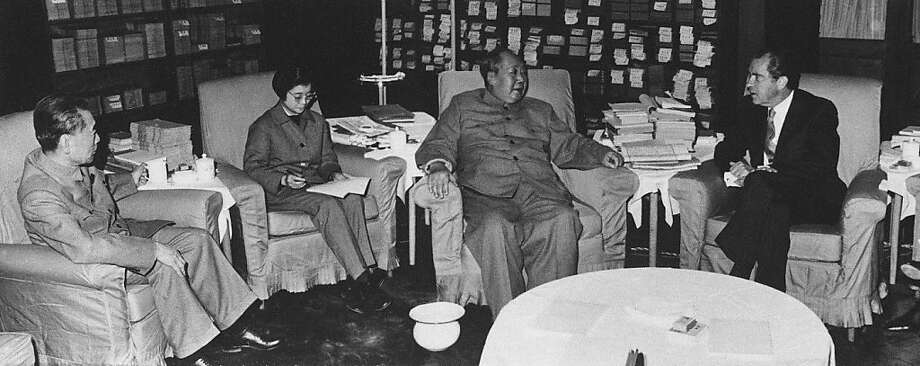 Mao Tse-Tung, second from left, Chinese communist party leader, talks with U.S. President Richard Nixon in Beijing, Feb. 21, 1972, hours after the president's arrival to China.  At left is Premier Chou En Lai and between the Chinese leaders is interpreter Tang Wen Shen.  (AP Photo) Photo: ASSOCIATED PRESS