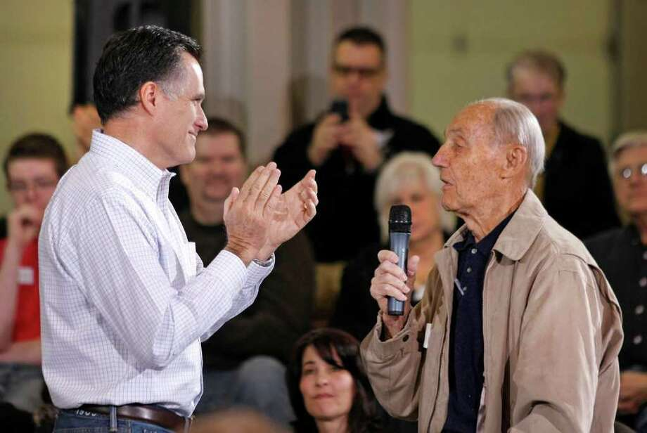 Republican presidential candidate, former Massachusetts Gov. Mitt Romney (L) applauds a 95 year-old WWII veteran during a town hall meeting campaign stop at Eagle Manufacturing Corporation February 21, 2012 in Shelby Township, Michigan. Photo: Bill Pugliano, Getty Images / 2012 Getty Images