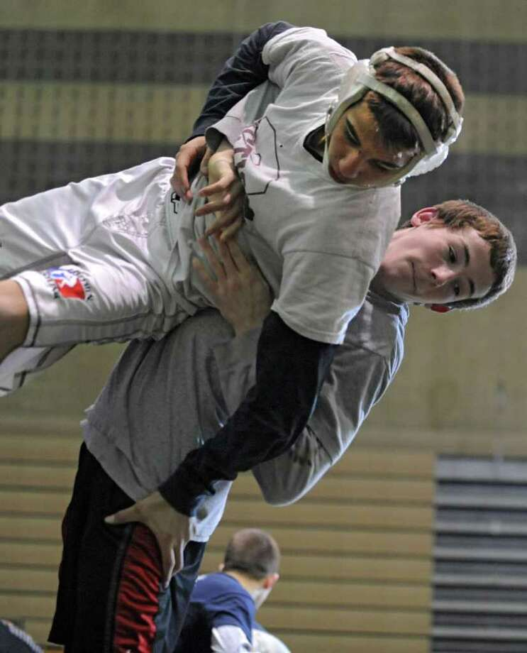 Joey Butler of Burnt Hills, right, and Brandon Lapi of Amsterdam practice at Shenendehowa High School for the NYS Wrestling Tournament Tuesday, Feb.21, 2012 in Clifton Park, N.Y.  (Lori Van Buren / Times Union) Photo: Lori Van Buren