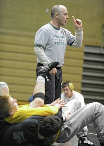 Shenendehowa coach Rob Weeks talks to high schools wrestlers from around the Capital District during a practice at Shenendehowa High School for the NYS Wrestling Tournament Tuesday, Feb.21, 2012 in Clifton Park, N.Y.  (Lori Van Buren / Times Union) Photo: Lori Van Buren