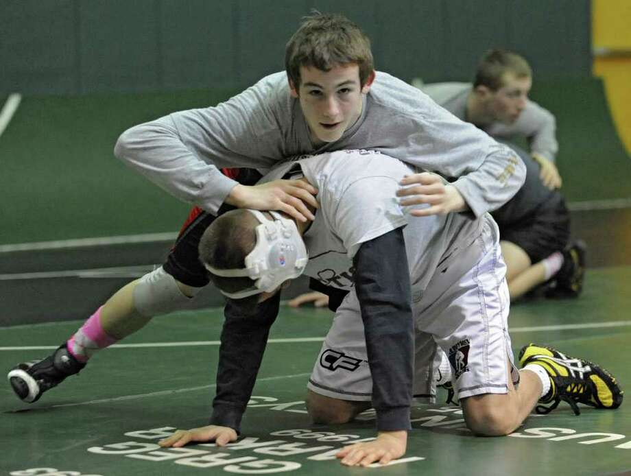 Joey Butler of Burnt Hills, top, and Brandon Lapi of Amsterdam practice at Shenendehowa High School for the NYS Wrestling Tournament Tuesday, Feb.21, 2012 in Clifton Park, N.Y.  (Lori Van Buren / Times Union) Photo: Lori Van Buren