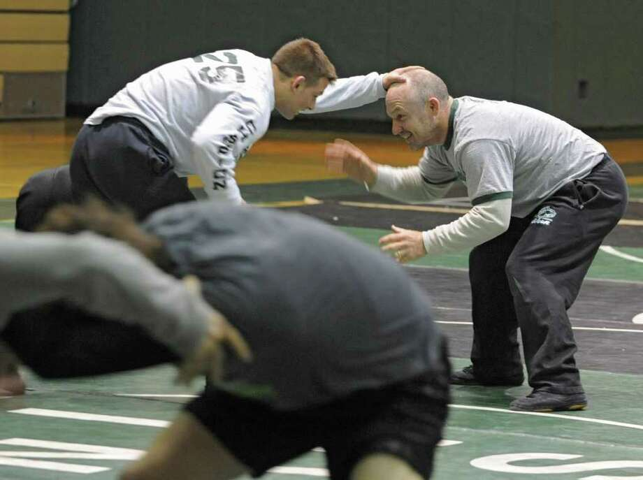 From left, David Almaviva of Shenendehowa wrestles with his coach Rob Weeks as high schools wrestlers from around the Capital District practice at Shenendehowa High School for the NYS Wrestling Tournament Tuesday, Feb.21, 2012 in Clifton Park, N.Y.  (Lori Van Buren / Times Union) Photo: Lori Van Buren
