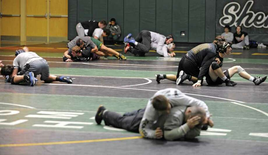 High schools wrestlers from around the Capital District practice at Shenendehowa High School for the NYS Wrestling Tournament Tuesday, Feb.21, 2012 in Clifton Park, N.Y.  (Lori Van Buren / Times Union) Photo: Lori Van Buren