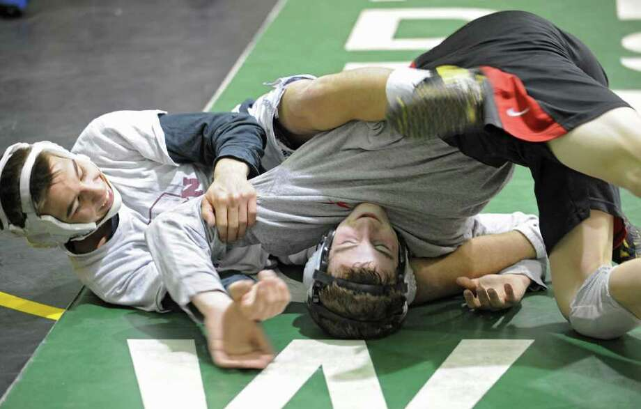 From left, Brandon Lapi of Amsterdam and Joey Butler of Burnt Hills practice at Shenendehowa High School for the NYS Wrestling Tournament Tuesday, Feb.21, 2012 in Clifton Park, N.Y.  (Lori Van Buren / Times Union) Photo: Lori Van Buren