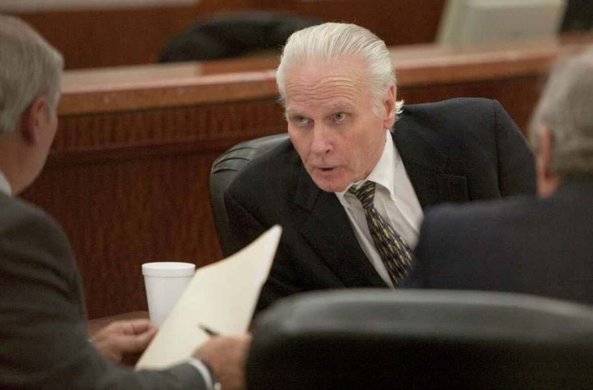 Convicted cop killer, Carl Wayne Buntion, talks with his attorneys during his sentencing retrial at the Harris County Criminal Courthouse, Tuesday, Feb. 21, 2012, in Houston. Carl Wayne Buntion was convicted of the 1990 killing of Houston Police Dept. motorcycle officer James Irby. ( Melissa Phillip / Houston Chronicle )