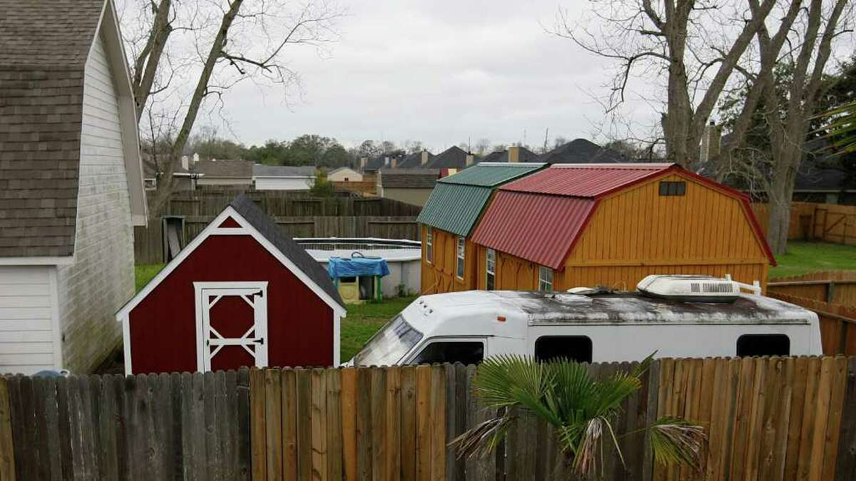 Next-door neighbor Wayne Hardin said he saw several of the adults using the three storage sheds in the backyard for sleeping because of the cramped accommodations in the house.