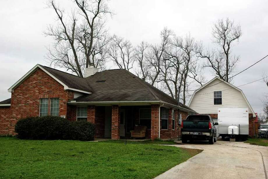 On Jan. 24, CPS found 11 children - ages 5 months to 11 years - living in this three-bedroom home with 10 adults. Photo: Johnny Hanson / © 2012  Houston Chronicle
