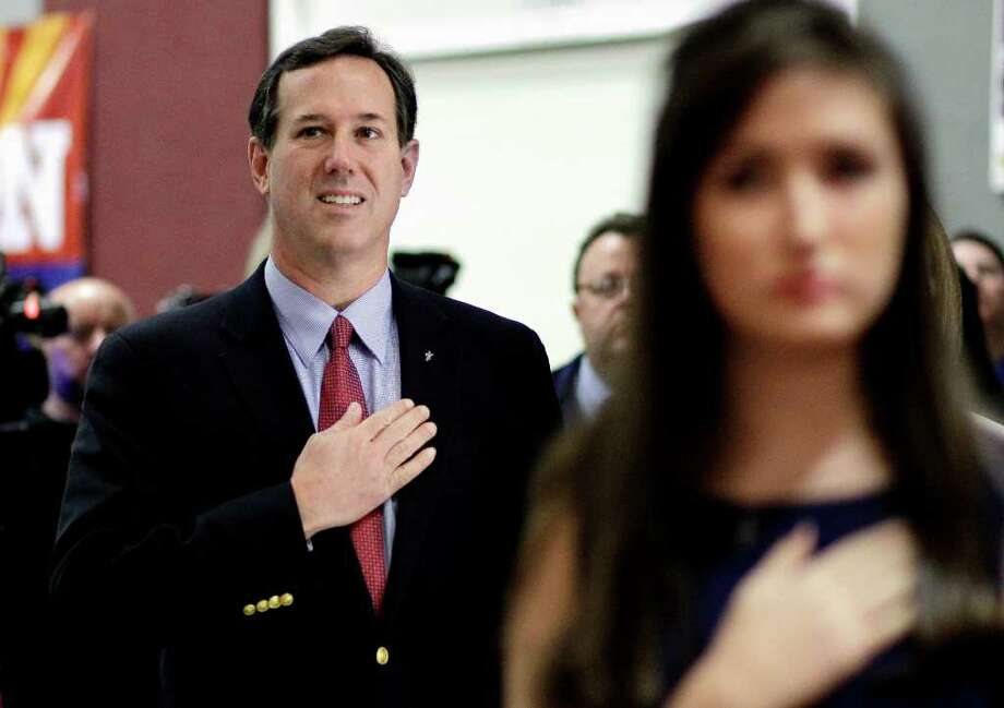 Republican presidential candidate, former Pennsylvania Sen. Rick Santorum, left, says the Pledge of Allegiance during a campaign stop at the Maricopa County Lincoln Day Luncheon, Tuesday, Feb. 21, 2012, in Phoenix, Arizona.  (AP Photo/Eric Gay) Photo: Eric Gay