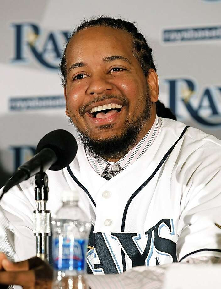 ST PETERSBURG, FL - FILE:  Manny Ramirez #24 of the Tampa Bay Rays talks with reporters at a press conference at Tropicana Field on February 1, 2011 in St Petersburg, Florida.  It was reported that Manny Ramirez has agreed to a deal with the Oakland Athletics in a deal that is estimated at $500,000 February 20, 2012.  (Photo by J. Meric/Getty Images) Photo: J. Meric, Getty Images