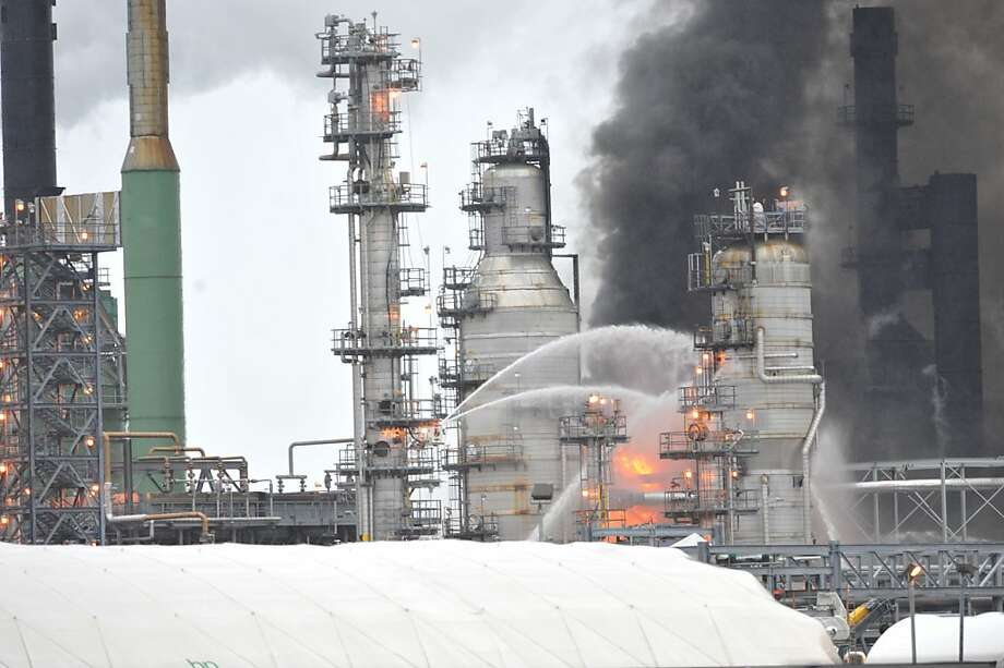BP Cherry Point Refinery fire, north of Ferndale, WA., Feb. 17, 2012. Fire crews doused a dramatic blaze that broke out Friday Feb. 17, 2012at Washington's largest oil refinery, sending up towering flames and creating a thick plume of black smoke visible for miles. No injuries were reported. (AP Photo/Philip A. Dwyer, Bellingham Herald) Photo: Philip A. Dwyer, Associated Press
