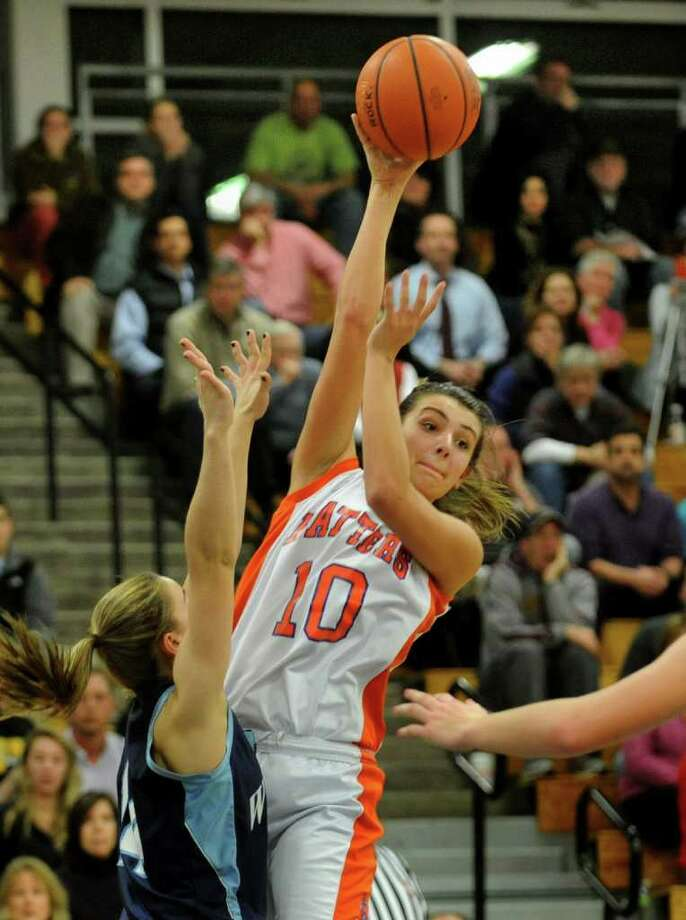 Danbury's #10 Casey Smith passes the ball instead of attempting a shot, during FCIAC Girls' Basketball Semi-final action against Wilton in Fairfield, Conn. on Tuesday February 21, 2012. Photo: Christian Abraham / Connecticut Post