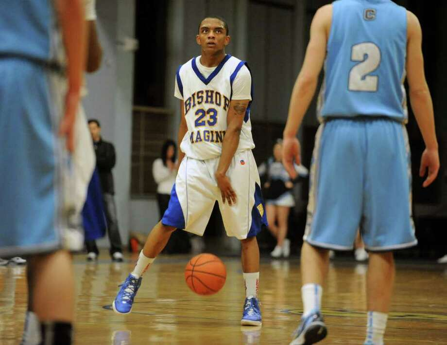 Bishop Maginn's Demere Hannah dribbles the ball between his legs as he looks at the clock during a basketball game against Columbia Tuesday, Feb.21, 2012 in Albany, N.Y.  (Lori Van Buren / Times Union) Photo: Lori Van Buren