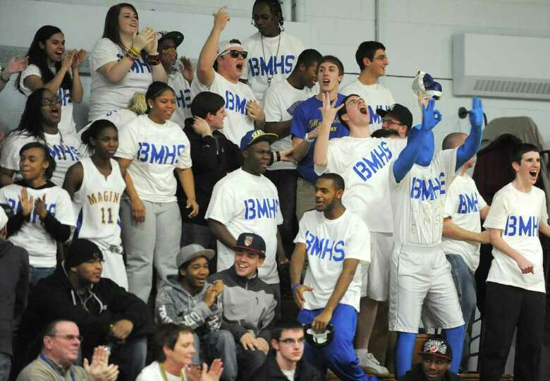 Bishop Maginn students go wild after their team takes the lead after being down most of the first ha