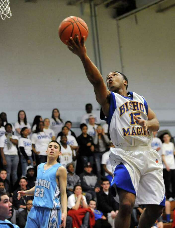 Bishop Maginn's Rushon Young goes up for two points during a fast break against Columbia  in a basketball game Tuesday, Feb.21, 2012 in Albany, N.Y.  (Lori Van Buren / Times Union) Photo: Lori Van Buren