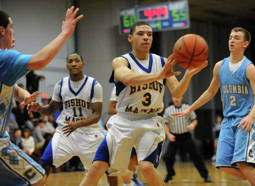Bishop Maginn's Nate Ikokwu passes the ball during a basketball game against Columbia Tuesday, Feb.2