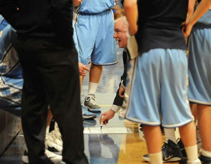 Columbia head coach Jim Obermayer tries to come up with play to come back and win during one of the