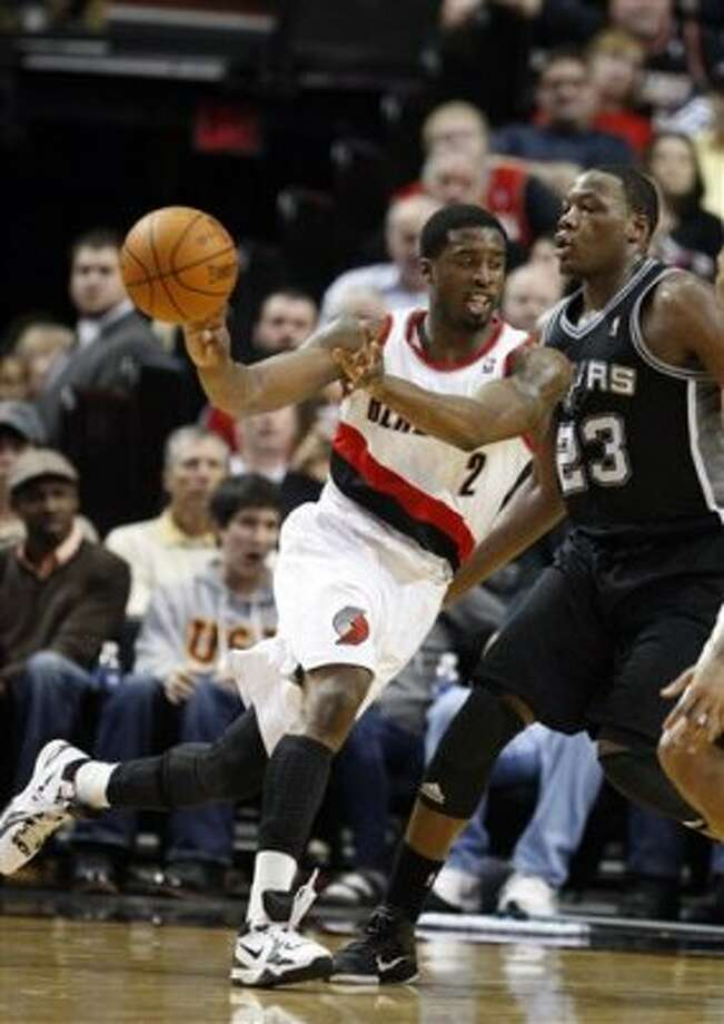 Portland Trail Blazers' Wesley Matthews (2) drives as San Antonio Spurs' Eric Dawson (23) defends in the second quarter of an NBA basketball game, Tuesday, Feb. 21, 2012, in Portland, Ore. (AP Photo/Rick Bowmer) (AP)