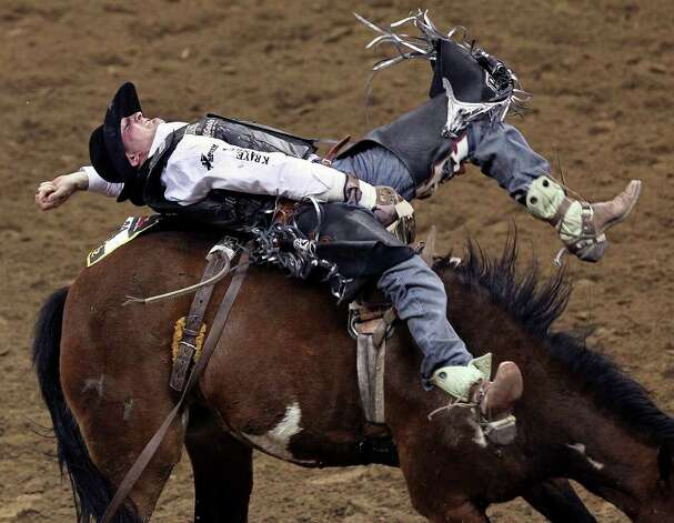 Steven Dent competes in the first round of the bareback semifinals at the San Antonio Stock Show & Rodeo on Tuesday, Feb. 21, 2012. Dent scored an 82 on the ride. Photo: TOM REEL, San Antonio Express-News / San Antonio Express-News