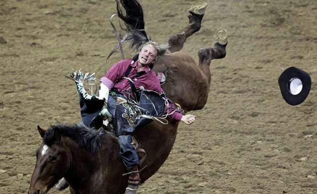 Craig Wisehart hangs on in the bareback competition at the San Antonio Stock Show & Rodeo on Tuesday, Feb. 21, 2012. Photo: TOM REEL, San Antonio Express-News / San Antonio Express-News