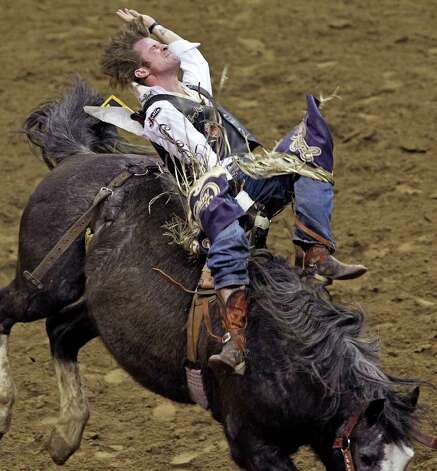 Tilden Hooper competes in the first round of bareback semifinals at the San Antonio Stock Show & Rodeo on Tuesday, Feb. 21, 2012. Hooper scored an 86 on the ride to lead. Photo: TOM REEL, San Antonio Express-News / San Antonio Express-News