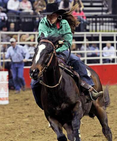 San Antonio's Andrea Cline-Herron rides in the barrel racing event at the San Antonio Stock Show & Rodeo on Tuesday, Feb. 21, 2012. Photo: TOM REEL, San Antonio Express-News / San Antonio Express-News